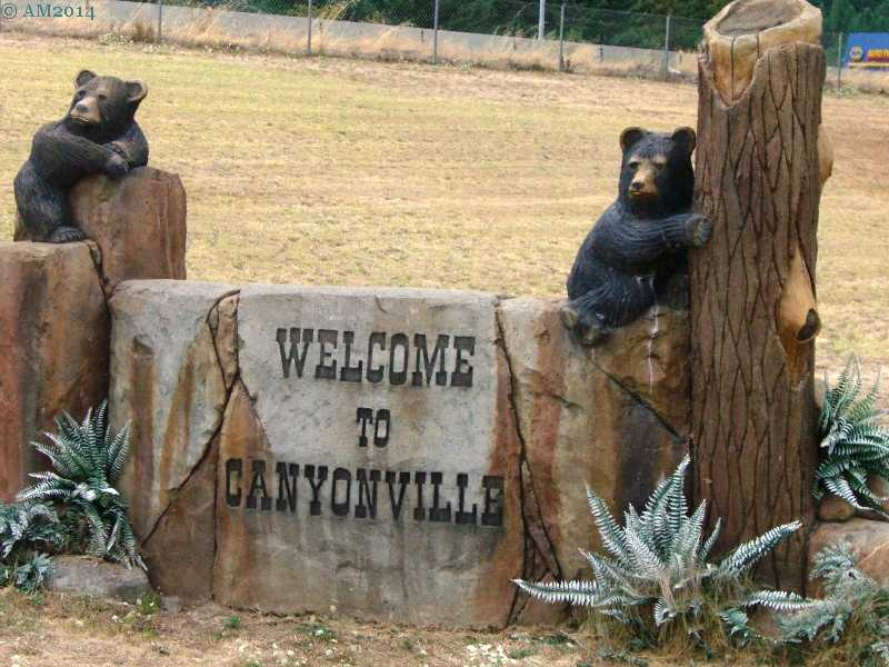 On the I-5 exit a welcome sign for Canyonville, Oregon.